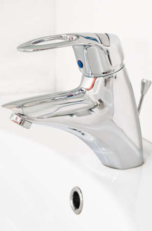 One chrome faucet in washbowl in bath room o white pile Stock Photo - 6748024