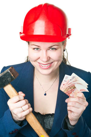 The girl in a building helmet with a hammer and cash in hands. It is isolated on a white background Stock Photo - 6802154