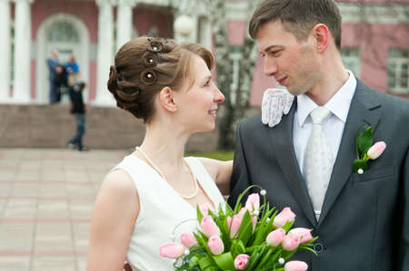 Young loving wedding couple with bunch of flowers. Newlywed pair Stock Photo - 7135173