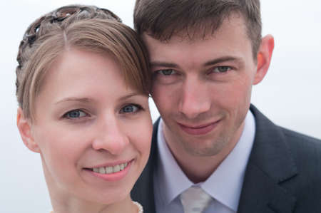 Young happy loving couple. Two faces close up photo