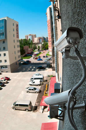 Optical camera on wall of building watching on parking place from top Stock Photo - 7682660