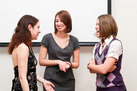 three women: Three business women talking togther in office room Stock Photo