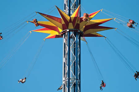 Action photo of carousel on blue sky photo