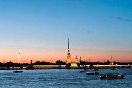 neva: Paul and Peter fortress in Saint Petersburg, Russia in white nights from Neva river. Nightscene