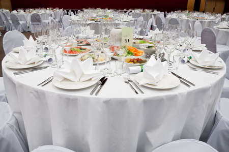 wedding table setting: Wedding white reception place ready for guests. Elegant banquet tables prepared for a conference or a party.