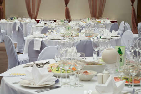 banquets: Wedding white reception place ready for guests. Elegant banquet tables prepared for a conference or a party.