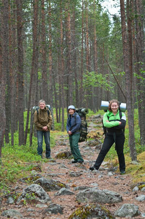 knapsacks: Group of travelers trekking in forest Mountaineering with knapsacks