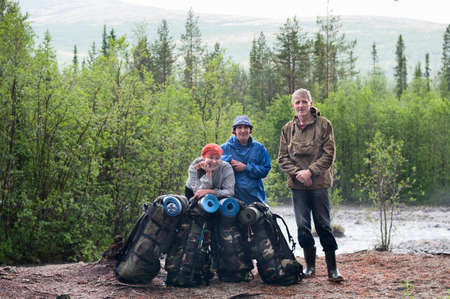 Group of travelers trekking in forest Mountaineering with knapsacks photo