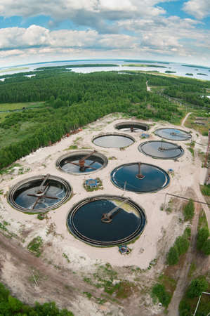 Group from the big sedimentation drainages. Water recycling, settling, purification in the tank by biological organisms on the water station. Stock Photo - 8080087