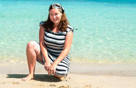 Young pretty girl on a sandy beach near the shore blue sea Stock Photo - 8267091
