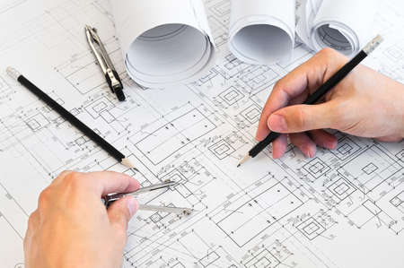 Design drawings and human hands drawing a project by pencil on paper Stock Photo - 8699798