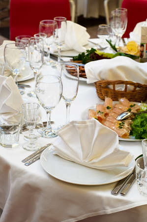 Elegant banquet and dinner tables prepared for a holiday or a party. photo