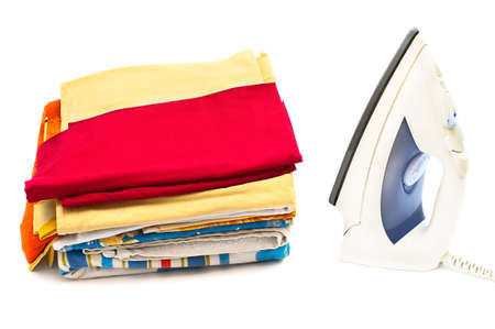 Flat electric iron and clothes on white background photo