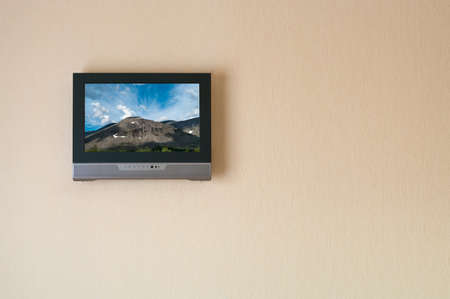 Liquid-crystal television receiver on wall. Picture on screen (I have rights). Copy space photo