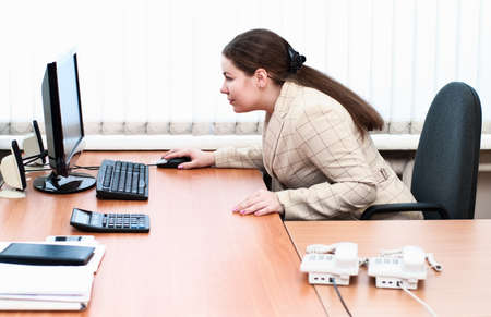 Young caucasian woman in office interior sitting at the working place Stock Photo - 9159932