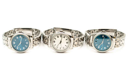 Three stainless men`s wristwatches isolated on white background photo