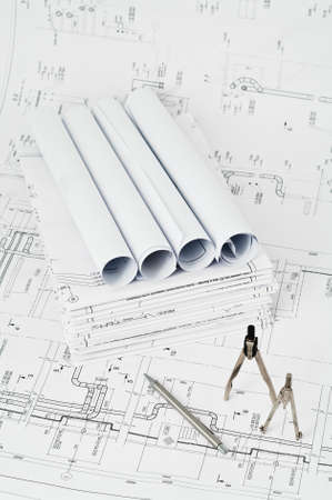 Design and working blueprints with pencils and compasses photo