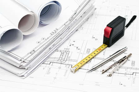 Design and working blueprints with pencils, rule and compasses photo