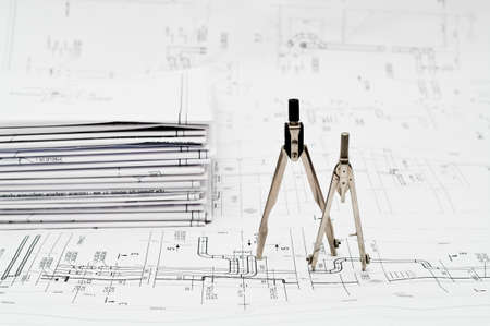 Design and working blueprints with compasses photo
