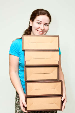 Young woman holding several carton boxes photo