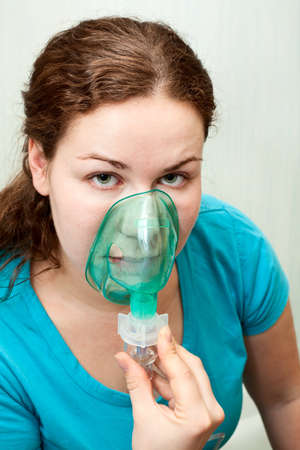 inhalation: Woman in medical inhalation mask breathing