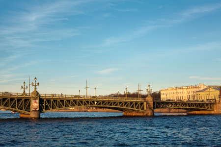 neva: Trinity bridge across the river Neva, Russia, St. Petersburg. Blue sky with clouds
