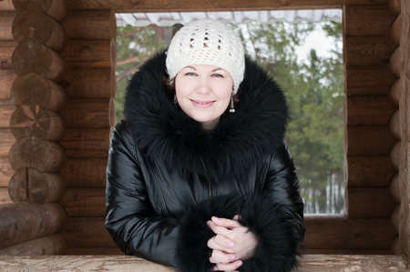 Young woman in the hat and coat. Outdoors photo