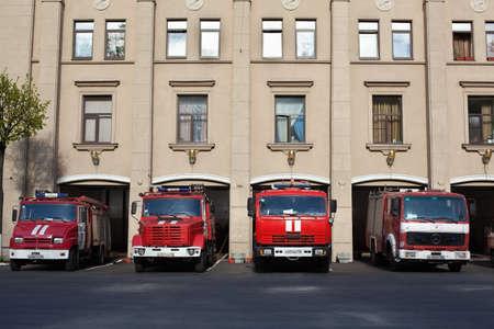 Saint-Petersburg, Russia - May 18, 2011 - Red Russian firefighting vehicles near garage