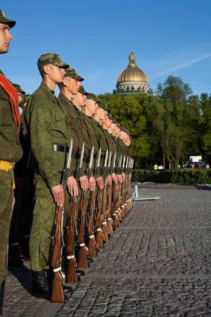 selebration: Saint-Petersburg, Russia - May 26 - Soldiers in the line near the monument to Peter the Great. City Day Celebration on Senate Square