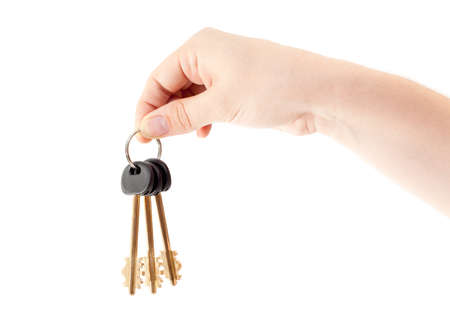 Human hand with bundle of home keys isolated on white background photo