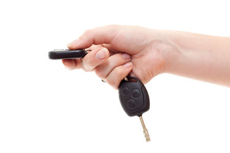 car keys: Hand with alarm keys pushing the button. Isolated on white