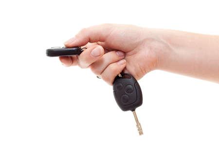 Mano con claves de alarma al presionar el botón. Aislados en blanco Foto de archivo