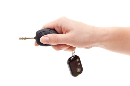 Hand with car keys. Isolated on white. Inserting key Stock Photo - 10215691