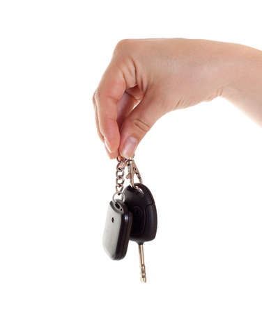 key in chain: Hand with car keys. Isolated on white.  Stock Photo