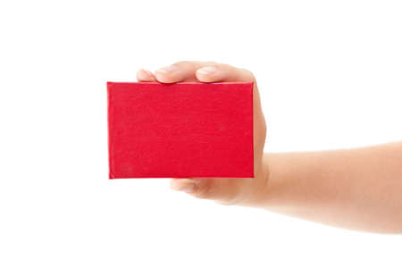 deletion: Red card in human hand isolated on white background Stock Photo