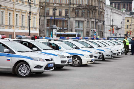 patrolling: Saint-Petersburg, Russia - May 5 - Russian policeman vehicles parking in line in Palace square