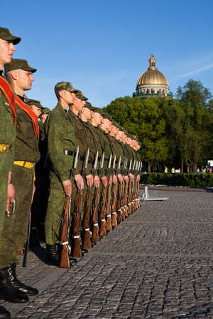 squad: Saint-Petersburg, Russia - May 26 - Soldiers in the line near the monument to Peter the Great. City Day Celebration on Senate Square