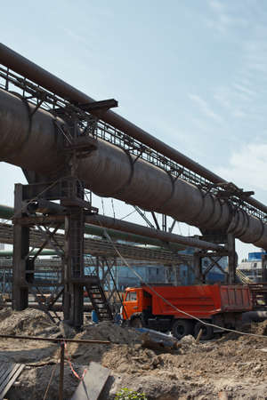 Industrial gas and oil pipelines on metal in a metallurgical plant. Construction area Stock Photo - 10330886