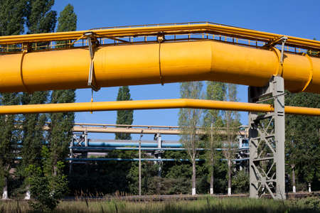 Industrial gas and oil pipelines on metal in a metallurgical plant. Stock Photo - 10326543