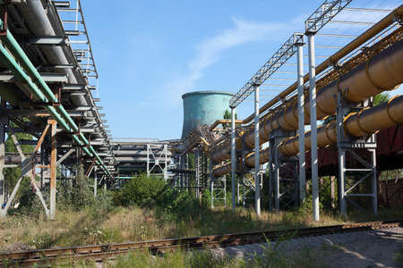 Industrial gas and oil pipelines on metal in a metallurgical plant. Stock Photo - 10326548