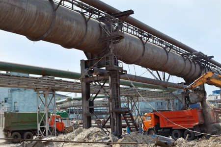 Industrial gas and oil pipelines on metal in a metallurgical plant. Construction area Stock Photo - 10326539