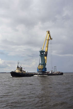 floatable: St. Petersburg, Russia – July 17: Transportation floating crane in the Finnish Gulf in Saint-Petersburg, Russia