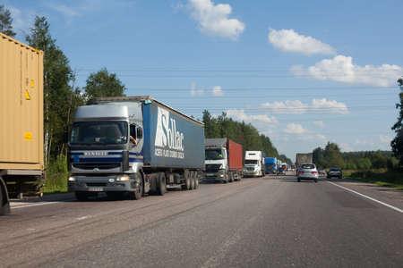 st. petersburg, russia - July 19, traffic jam of trucks on the road of saint-petersburg-moscow