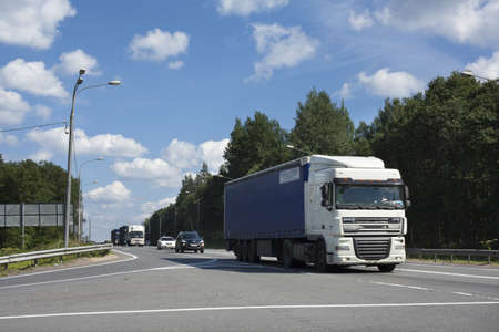russian car: st. petersburg, russia - July 19, traffic jam of trucks on the road of saint-petersburg-moscow