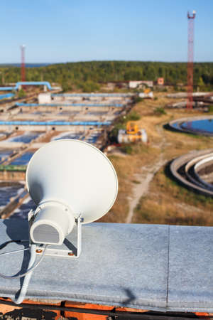 public address: Warning system megaphone on the roof of industrial building in factory territory