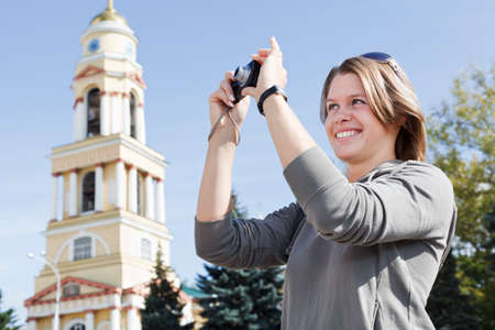 only teenagers: Young beautiful woman photographing city`s attractions