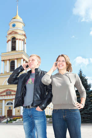 Young couple man and woman speaking by mobile phone at the same time Stock Photo - 10949736