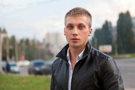 Portrait of a handsome man in a black jacket. Blond hair. Copyspace photo