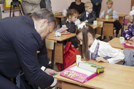 Saint-Petersburg, Russia-September, 1, 2011: Leningrad region Governor Valery Serdyukov in classroom during lesson in Russian school. Stock Photo - 11078963