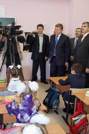 governor: Saint-Petersburg, Russia-September, 1, 2011: Leningrad region Governor Valery Serdyukov in classroom during lesson in Russian school.